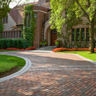 Design ideas for a large traditional front yard brick driveway in Minneapolis.
