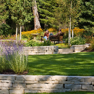 Inspiration for a contemporary retaining wall landscape in Minneapolis.