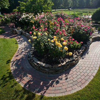 Design ideas for a large shabby-chic style full sun backyard stone formal garden in Raleigh.
