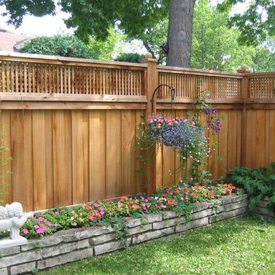 Design ideas for a large transitional partial sun backyard wood fence formal garden in Minneapolis.