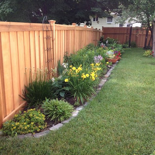Photo of a large transitional backyard partial sun formal garden in Minneapolis with a garden path and mulch.