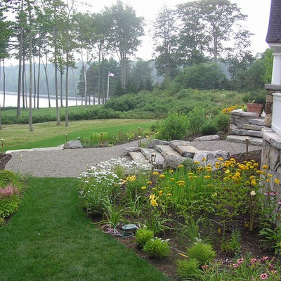 Photo of a traditional backyard gravel landscaping in Manchester.