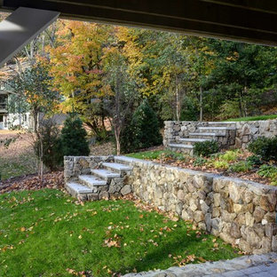 Inspiration for a large traditional partial sun backyard landscaping in Boston for fall.