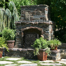 Traditional Landscape by Custom Design & Construction