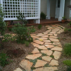 Traditional Landscape by Earth Design, Inc.