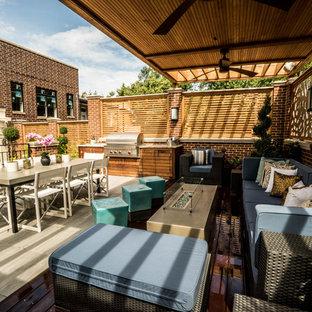 Immagine di un giardino contemporaneo esposto a mezz'ombra di medie dimensioni e sul tetto in primavera con pavimentazioni in cemento