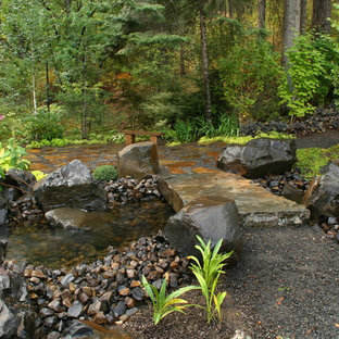 This is an example of a large traditional backyard landscaping in Seattle.
