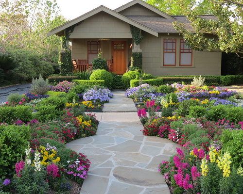 photo of a mid sized craftsman front yard stone landscaping in houston for summer - Front Yard Design Ideas