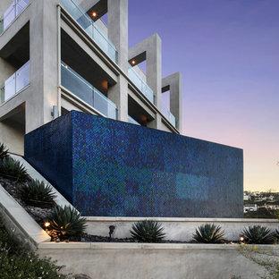 Inspiration for a contemporary full sun hillside water fountain landscape in Orange County.