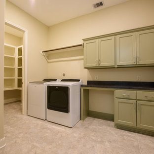 This is an example of a medium sized traditional single-wall separated utility room in Houston with shaker cabinets, green cabinets, granite worktops, beige walls, porcelain flooring, a side by side washer and dryer and black worktops.