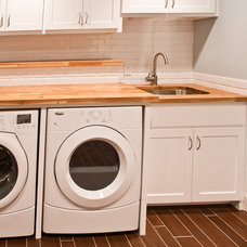 Contemporary Laundry Room by Modern Craft Construction, LLC