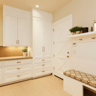 Mid-sized transitional l-shaped beige floor and porcelain floor dedicated laundry room photo in Portland with a drop-in sink, recessed-panel cabinets, white cabinets, beige walls, solid surface countertops and beige countertops