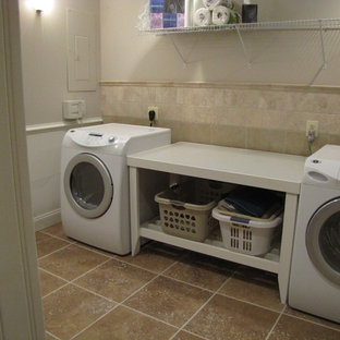 Mid-sized elegant single-wall laundry room photo in DC Metro with a single-bowl sink, beige walls and a side-by-side washer/dryer