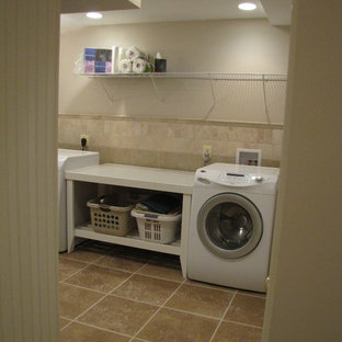 Inspiration for a mid-sized contemporary single-wall laundry room remodel in DC Metro with a single-bowl sink, beige walls and a side-by-side washer/dryer