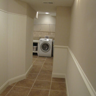 Laundry room - mid-sized traditional single-wall laundry room idea in DC Metro with a single-bowl sink, beige walls and a side-by-side washer/dryer