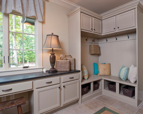 Marvelous Example Of A Classic Beige Floor Laundry Room Design In Other With Beige  Cabinets