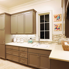 traditional laundry room by Castle Homes