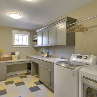 Inspiration for a timeless multicolored floor laundry room remodel in Minneapolis with a drop-in sink