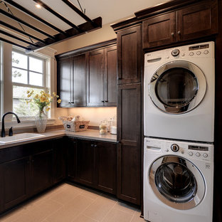 Laundry room - traditional laundry room idea in Minneapolis with a stacked washer/dryer and beige countertops