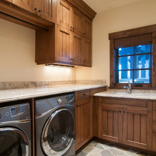 Rustic Laundry Room by Cameo Homes Inc.