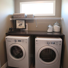 Eclectic Laundry Room by Milestone Homes