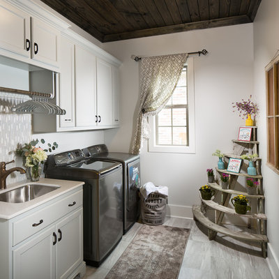 Dedicated laundry room - mid-sized country single-wall ceramic tile dedicated laundry room idea in New Orleans with an undermount sink, a side-by-side washer/dryer and recessed-panel cabinets