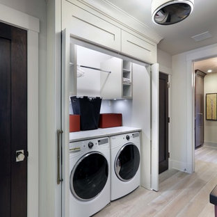 Small Minimalist Single Wall Light Wood Floor And Brown Laundry Closet Photo With Open