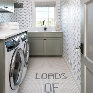 Laundry room - traditional multicolored floor laundry room idea in Minneapolis with a single-bowl sink, shaker cabinets, gray cabinets, multicolored walls and white countertops