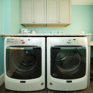 Elegant laundry room photo in Manchester