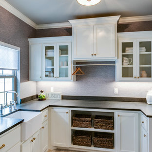 Rural u-shaped utility room in Austin with shaker cabinets, white cabinets, granite worktops, a side by side washer and dryer and black worktops.