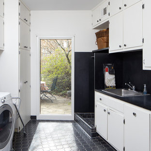 Mid-sized midcentury galley dedicated laundry room in Birmingham with a drop-in sink, flat-panel cabinets, white cabinets, laminate benchtops, white walls, ceramic floors and a side-by-side washer and dryer.