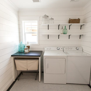 Example of a beach style single-wall white floor laundry room design in Phoenix with granite countertops, white walls and a side-by-side washer/dryer