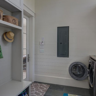 Beach style galley utility room photo in Miami with a farmhouse sink, recessed-panel cabinets and gray cabinets