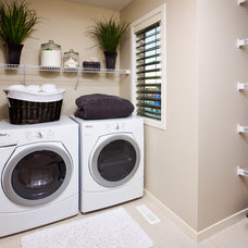 Modern Laundry Room by Cedarglen Homes