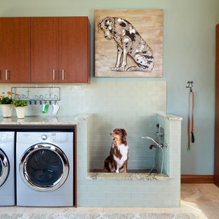 This is an example of a rustic l-shaped utility room in Denver with flat-panel cabinets, a side by side washer and dryer, beige floors and beige worktops.