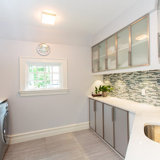 Design ideas for a large victorian galley separated utility room in Boston with flat-panel cabinets, grey cabinets and white walls.