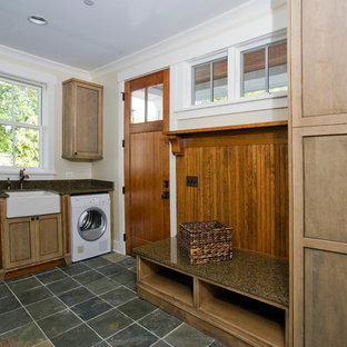 Laundry room - craftsman slate floor laundry room idea in Chicago with a farmhouse sink