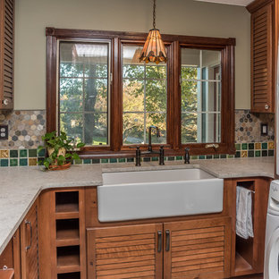 Photo of a large traditional u-shaped utility room in Detroit with a belfast sink, open cabinets, distressed cabinets, engineered stone countertops, green walls, slate flooring, a stacked washer and dryer, multi-coloured floors and multicoloured worktops.