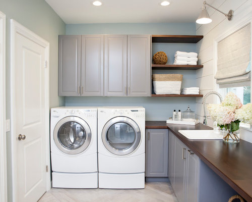 Example Of A Large Classic L Shaped Porcelain Floor Dedicated Laundry Room  Design In New