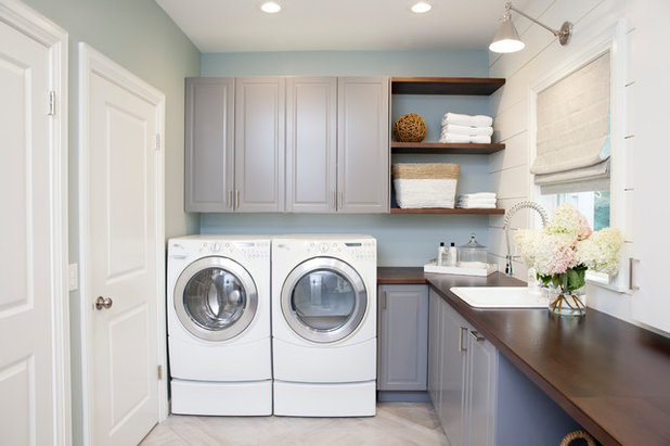 Traditional Laundry Room by STUDIO ENVIE