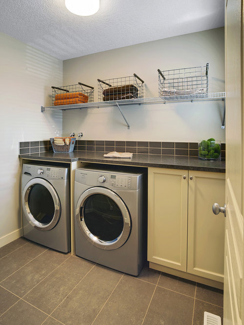 Trendy Gray Floor Laundry Room Photo In Edmonton With Recessed Panel Cabinets And Green