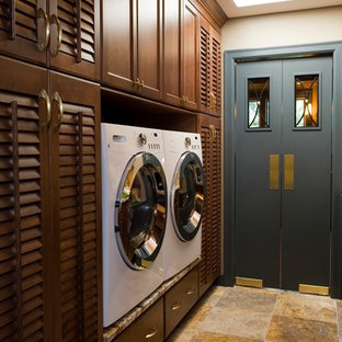 Traditional dedicated laundry room in Other with louvered cabinets, dark wood cabinets and a side-by-side washer and dryer.