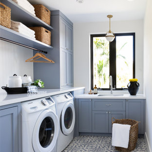 Transitional laundry room photo in Miami