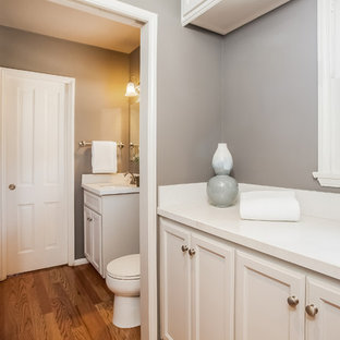 Large transitional l-shaped light wood floor laundry room photo in Los Angeles with an undermount sink, shaker cabinets, white cabinets, quartzite countertops, gray walls and a side-by-side washer/dryer