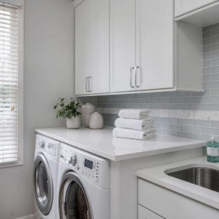 Inspiration for a mid-sized transitional single-wall dedicated laundry room remodel in Detroit with an undermount sink, shaker cabinets, white cabinets, quartz countertops, gray walls and gray countertops