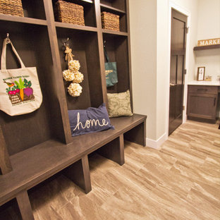 Design ideas for a large u-shaped utility room in Other with an utility sink, shaker cabinets, brown cabinets, engineered stone countertops, beige walls, vinyl flooring, a side by side washer and dryer, beige floors and beige worktops.