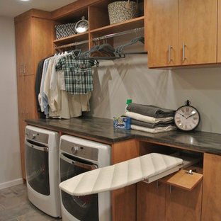 Mid-sized elegant laundry room photo in DC Metro with flat-panel cabinets, medium tone wood cabinets and gray walls