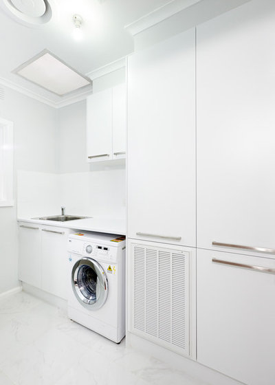 Modern Laundry Room by Damco Kitchens