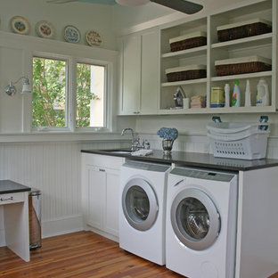 Elegant laundry room photo in Atlanta with white cabinets