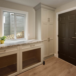 Inspiration for a large contemporary single-wall separated utility room in Vancouver with shaker cabinets, beige cabinets, quartz worktops, beige walls, medium hardwood flooring and brown floors.